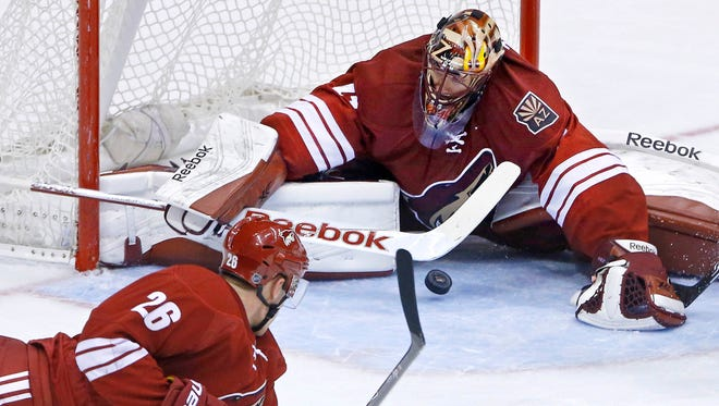 Arizona Coyotes goalie Mike Smith blocks a shot against the St. Louis Blues  during the second period on Tuesday, Jan. 6, 2015, in Glendale.