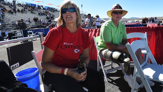 Linda Elvin, left, and her husband, Brian, watch as a plane goes by during the Reno National Championship Air Races at Stead Airport on Thursday.