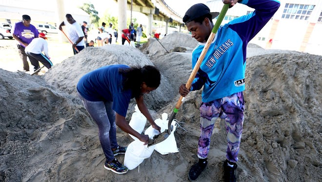 New Orleans residents fill sand bags in preparation for Hurricane Nate.