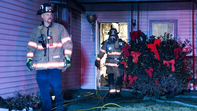 Evansville city firefighters exit one of the rooms of a working house fire at 1507 Florence Street Thursday evening, January 4, 2018.