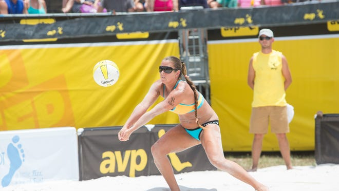 Former Canterbury and FGCU standout Brooke Sweat digs the ball during the final at the AVP St. Petersburg Open on June 1, at Spa Beach Park in St Petersburg.