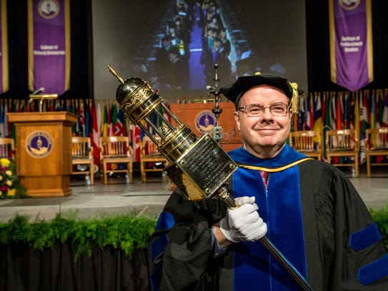As grand marshal of the UW-Stevens Point winter commencement,