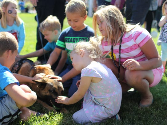 Children pet Chance, an Anderson Police Department