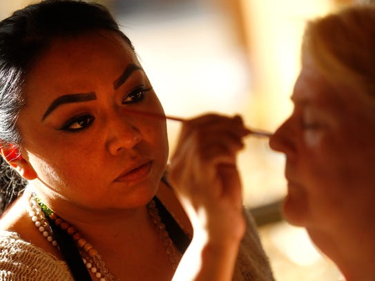 San Juan College aesthetician student Stephanie Smith applies makeup to Carolyn Beavers Thursday at the Bloomfield Senior Center.