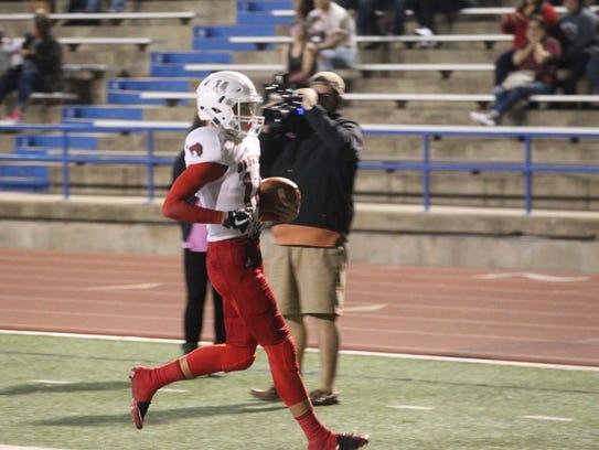 Sonora High School quarterback Kaden Cordell runs for