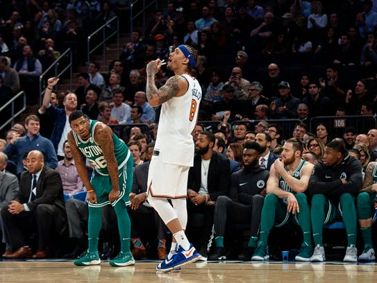 New York Knicks' Michael Beasley, center looks at the