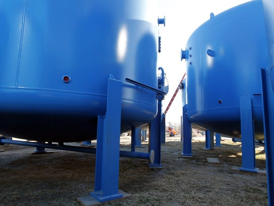 Water filtration tanks wait to be placed in the groundwater
