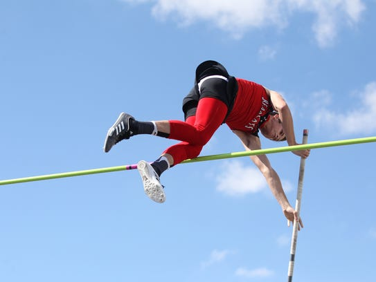 Ballinger's Kennedy Byler clears the bar during the