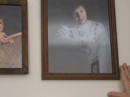 Beverly Hindman points to a picture of her daughter Carrie, who passed away from a blood clot in 2011. Her corneas would later give two people the ability to see.