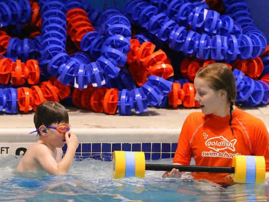 Carter Sobush works with Rachel Koch in an individual lesson at Goldfish Swim School in Brookfield on April 12.