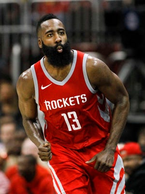 Houston Rockets guard James Harden (13) reacts after making a three point basket against the Atlanta Hawks in the third quarter at Philips Arena.