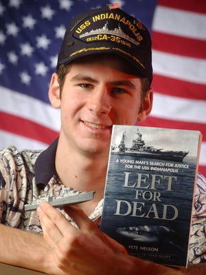 """Hunter Scott, in 2002, with his book """"Left for Dead."""""""