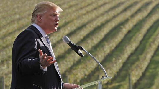 Donald Trump talks in front of rows of grapevines during a 2011 news conference at his winery in Charlottesville, Va., after he bought the winery once owned by socialite Patricia Kluge.
