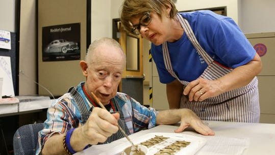 Jean Howard, an activities coordinator, cares for Joey McElfresh at Centers for Habilitation on Nov. 22. The Tempe-based company provides programs for individuals with intellectual and developmental disabilities.