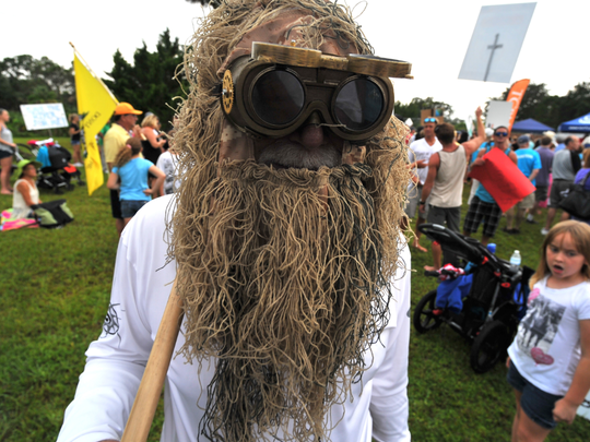 "Donald ""Captain Don""  Voss of the Marine Cleanup Initiative in Fort Pierce wears his ""Muck Monster"" costume during a rally in August 2013 at Phipps Park near the St. Lucie Lock and Dam to protest Lake Okeechobee discharges."