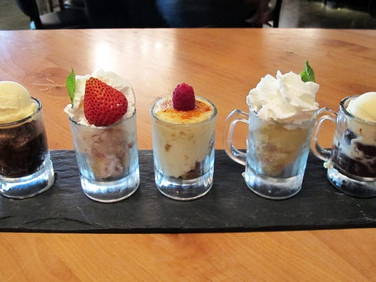 Desserts, served in small glass mugs, include options such as double chocolate cake, strawberry shortcake, cheesecake, lemon bar and caramel pretzel brownie at Burntwood Tavern in Mercato in North Naples.