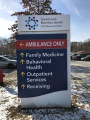 A directory sign at JFK Health Center's campus, which