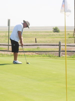 Rob Tryon putts to the ninth hole in the La Junta Seniors Golf League tournament Tuesday at the La Junta Municipal Golf Course.