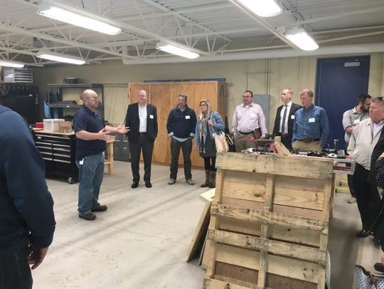 Developers tour attendees at Sheboygan North High School's