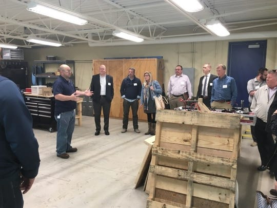 Developers tour attendees at Sheboygan North High School's Advanced Manufacturing Center