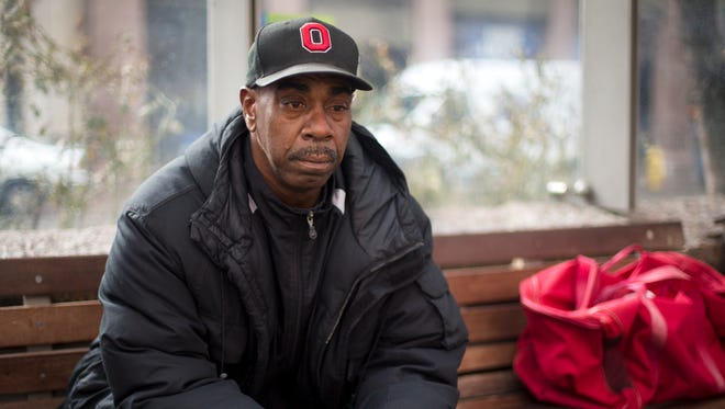 Tue., Jan. 19, 2016: Lonnie Parker of Roselawn sits at Government Square waiting for a bus as Donald Trump was taking his oath of office. He said that he had inauguration coverage on in the morning, but was to turn off the TV and leave his house.