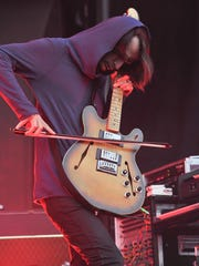 Radiohead's Jonny Greenwood focuses during the band's set at Outside Lands festival in San Francisco.