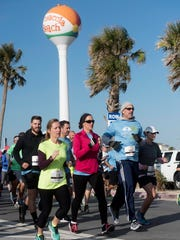 Scores of runners hit the streets at Santa Rosa Island Thanksgiving morning, Nov. 23, 2017, for the annual Pensacola Beach Turkey Trot. This is a seventh-anniversary of the event.