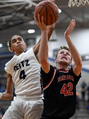 Harrison's Riley Epley (42) shoot past defense from Reitz's Kristian Lander (4) as the the Reitz Panthers play the Harrison Warriors at Reitz Thursday, February 8, 2018.