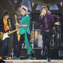 Mick Jagger (R), Keith Richards (C) and Ronnie Wood from British rock group The Rolling Stones, perform on stage at Hayarkon Park in the Mediterranean coastal city of Tel Aviv, on June 4, 2014. The Rolling Stones staged a live concert in Tel Aviv as a part of their '14-On-Fire' world tour.