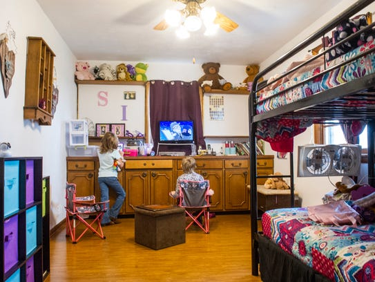Indianola foster families live in close quarters. Sami and Iszie Kennard study, play games and sleep in this room.