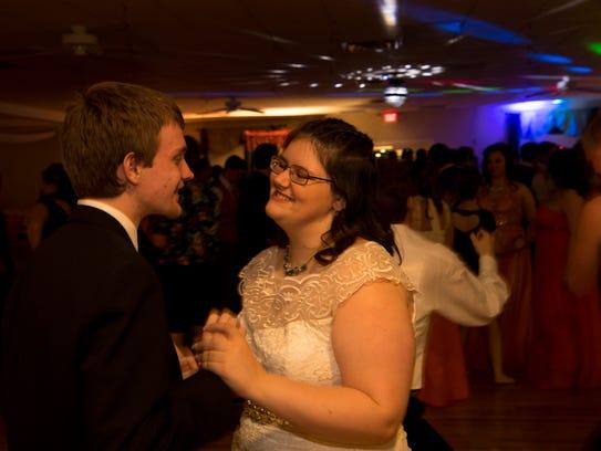 Josiah Williams, 16, and Kaylee Harrison, 18, dance