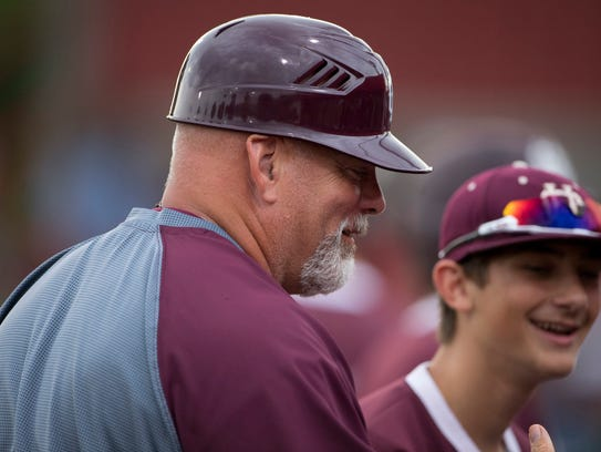 Henderson County Asst. Coach J.D. Arndt keeps the dugout