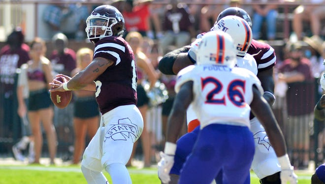 Mississippi State Bulldogs quarterback Dak Prescott (15) drops back in the pocket during the first quarter of the game against the Northwestern State Demons at Davis Wade Stadium. Mississippi State won 62-13.