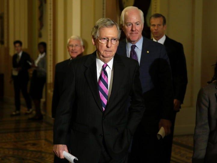 Senate Majority Leader Mitch McConnell, R-Ky., left,