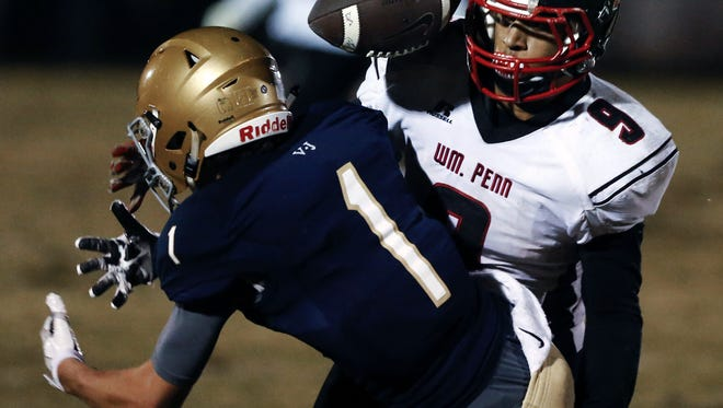 William Penn's Isaiah Gaynor (9) breaks up a fourth-down pass intended for Salesianum's Mike DiNardo in the final minute to preserve the Colonials' 21-14 win on Friday. William Penn moved up to No. 3 in The News Journal's Division I rankings.