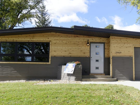 The exterior now features cedar and metal siding. (Photo: Elisha Page