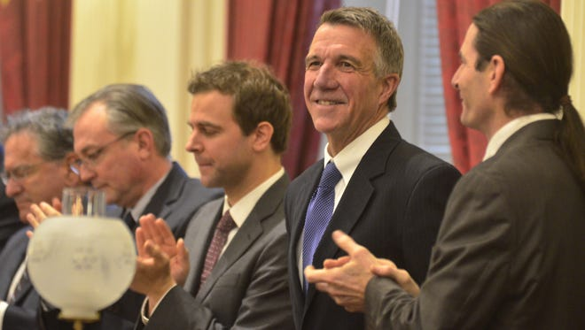 Surrounded by Democratic and Progressive Senate leaders, Republican Gov. Phil Scott welcomes applause just before his first budget speech in Montpelier on Jan. 24, 2017.