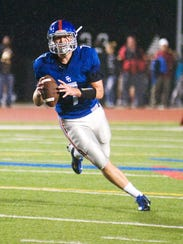 Spring Grove quarterback Matt Runge has had a major role in leading the first-place Rockets to a 6-2 record this year. (The Evening Sun -- Clare Becker)