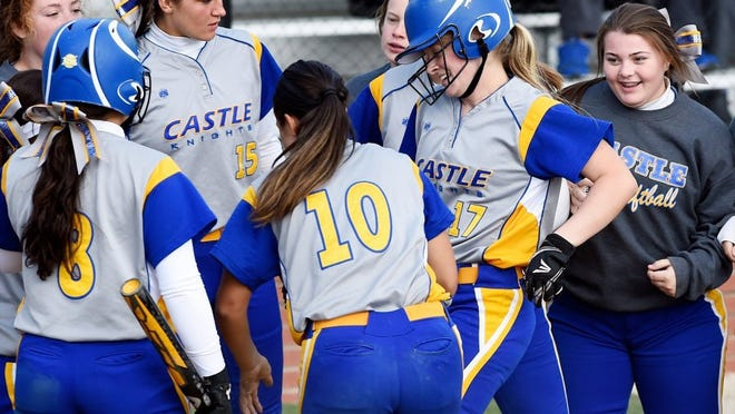 MIKE LAWRENCE / COURIER & PRESS Castle teammates congratulate Paiten Bradford, number 17, after hitting a home run in Saturday's game with Booneville at the Warrick County Showcase softball tournament in Boonville.