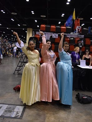 "Cosplayers go to ""Work"" as the Schuyler sisters from"
