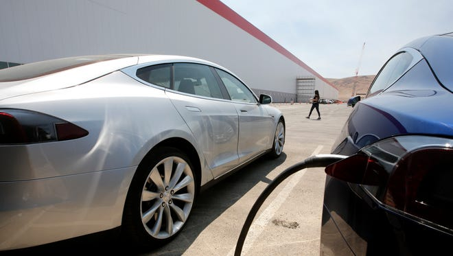 Tesla Motors model S cars are charged at the new Tesla Gigafactory, Tuesday, July 26, 2016, in Sparks, Nev.