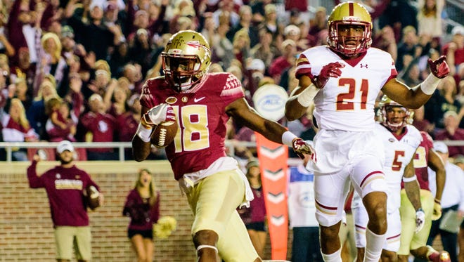 Auden Tate (18) breaks through the defense for a touchdown during the 45-7 Florida State University victory against Boston College on Fri., Nov. 11, 2016 at Doak Campbell Stadium, in Tallahassee, FL.