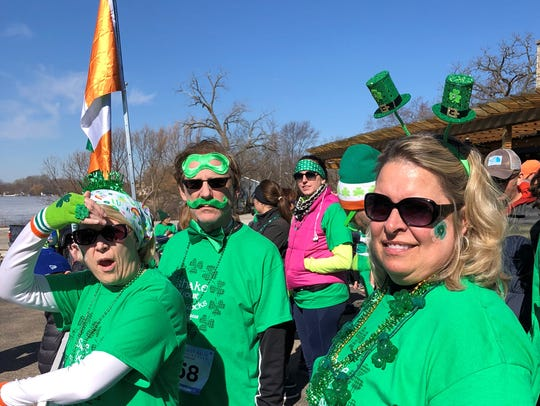 People watch the runners in the Shake Your Shamrocks