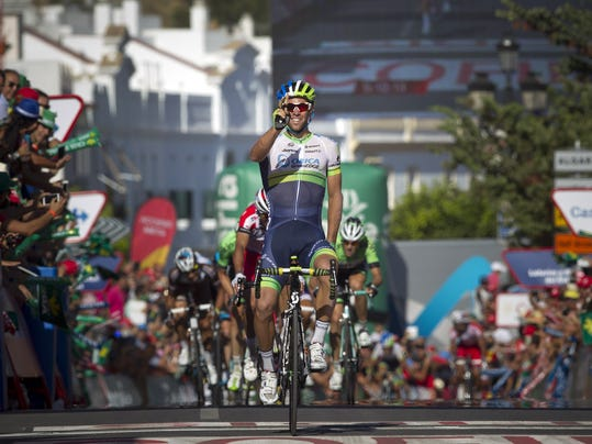 Australian rider Michael Matthews of Orica GreenEdge celebrates his victory on the finish line of the third stage of the Spanish Vuelta, in Arcos de La Frontera, Cadiz, Spain, Monday Aug. 25, 2014. The third stage of the Spanish Vuelta cycling race over 188 kilometers started in Cadiz. (AP Photo/Miguel Angel Morenatti)