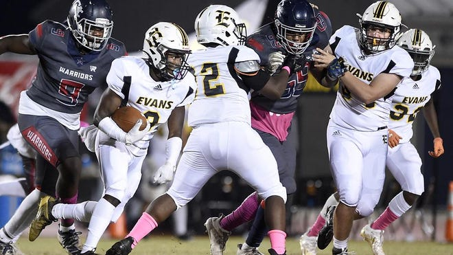 Evans' Caleb Fleming gets some yardage on Grovetown thanks to some great blocking during football action at Grovetown High School in Grovetown, Ga., Friday evening October 16, 2020