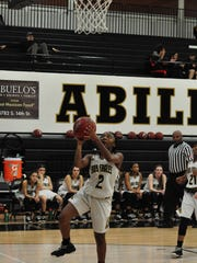 Abilene High's Sandrine Tuyizere goes up for a layup