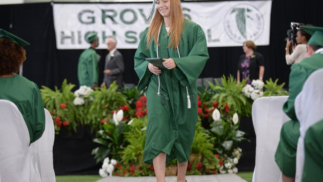 Graduates return to their seats during a previous Groves commencement in this file photo.