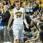 Iowa forward Jarrod Uthoff (20) high fives teammates on the bench during the second half against Northwestern at Carver-Hawkeye Arena. The Hawkeyes won 85-71.