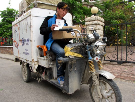 Lin Liwen, 25, delivers a box of party goods.