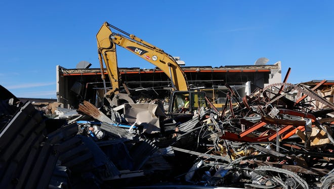 A crew with Coronado Wrecking and Salvage Company Inc. works Thursday to demolish a portion of Nataani Nez Elementary School in Shiprock.